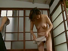 Mature Japanese woman washes a guy and gets fucked