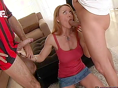 Janet Mason sucks two shafts and gets fucked doggy style