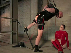 A spreader bar was perfect for that dude in latex