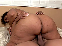 Ebony BBW sucks and rides big black cock in a bedroom