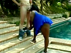 Very fat Black chick gives a blowjob to White guy outdoors