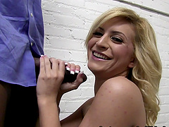 Backstage clip with Caprice Capone sucking a black schlong