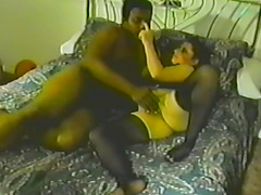 Hot babe is fucked by a black cock in vintage clip