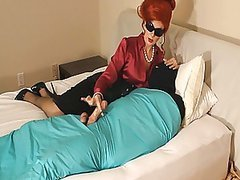 Redheaded Milf Applies Femdom To A Big Cock
