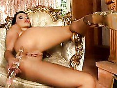 Elegant Brunette Masturbates On A Chair With Her Legs Wide Open