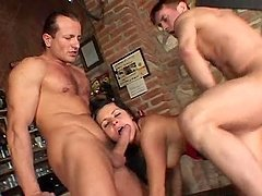 Stunning brunette chick gets fucked in both holes by two guys