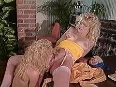 Nina Hartley is having fun with a lady in the office
