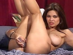 Gorgeous Tera Patrick fingers herself lying on the bed