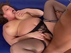 Fat babe in lingerie gives blowjob and titjob before getting fucked