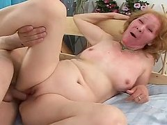 Horny grandma rubs her pussy and sucks his cock