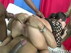 Gorgeous brunette warms up her pussy and gets three huge cocks