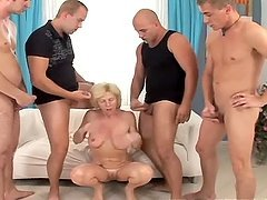 Granny Takes On Multiple Cocks.