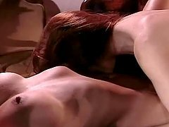 Two gorgeous lesbians fucking on the table