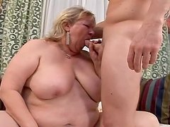 Fat granny Jane fucks a guy and gets a cumshot on her huge boobs