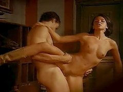 Sexy brunette gets fucked on a table after sucking a hard prick