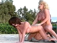 Skye Blue and Tracey West make lesbian love on the poolside