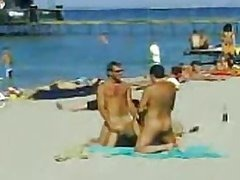 Two Guys and One Sexy Babe Have a Hot Threesome on a Nude Beach