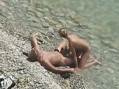 Sexy Blonde Babe Gives her Boyfriend a Blowjob on a Beach