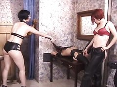 Lesbian Goth Dominatrix  Subdue a Female Slave with a Hot Booty