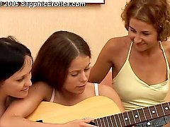 Three lewd girls fuck each other's pussies with dildos on the sofa