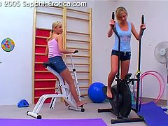 Two sexy blonde cuties playing with dildos in the gym